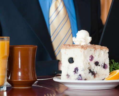 Hobee's blueberry coffeecake in front of business man