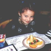 Gigi Chijate at Hobee's with a kids' menu and fruit platertrait