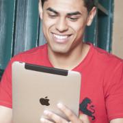 man using iPad with wifi
