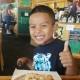 Boy and coffeecake at Hobee's Sunnyvale